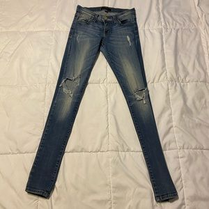 Skinny Blue Jeans with Holes in the Knee